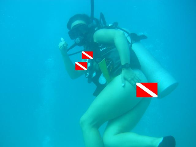 Naked Scuba Diver